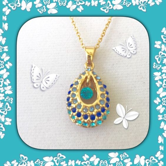 TURQUOISE AND BLUE SILVER NECKLACE  . The filigree on this necklace holds beautiful layers of crystal rhinestones. There's a row of turquoise and a row of blue with stunning crystal rhinestones bringing out the beauty of this very gorgeous necklace.  Jewelry Necklaces