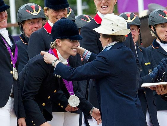 So proud ... Zara Phillips receives silver medal from her mum, Princess Anne