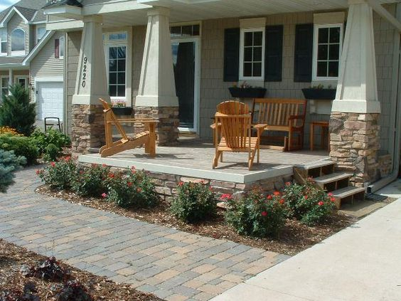 For renovated rancher add rock based pillars and extend for Front porch extension