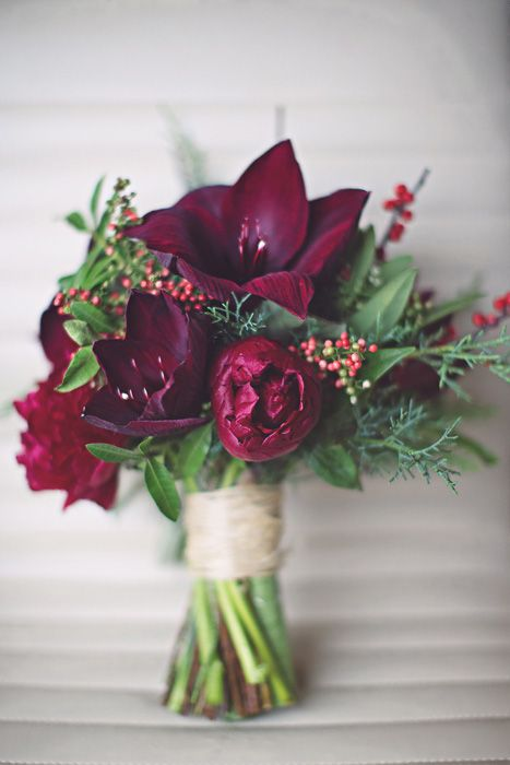 We briefly talked about the amaryllis bouquet to bring in the burgundy. It's a totally different style than the baby's breath but it could also be done with white flowers. We could also just use the amaryllis flowers in random little vases to bring in the burgundy colour on various tables, mis-matched around the room.:
