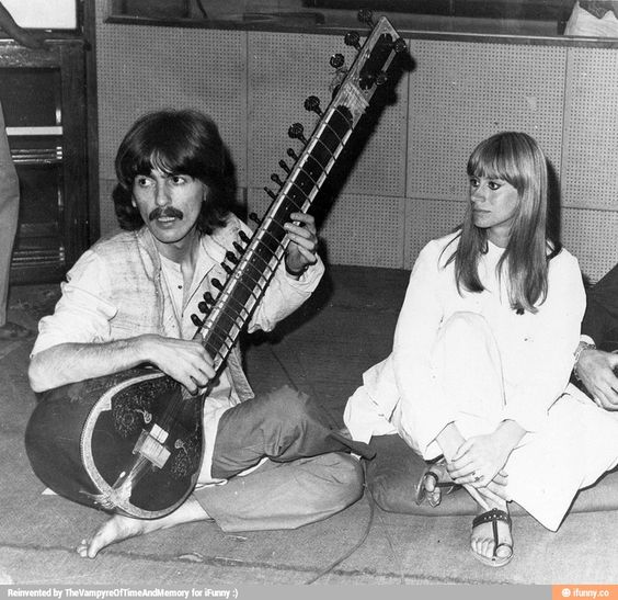 George Harrison, playing sitar, and Rita Tushingham