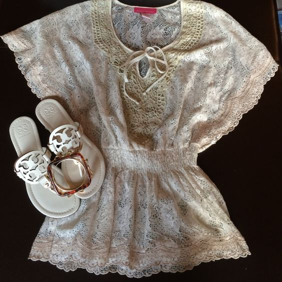 """Cream Colored Lace Top Cream top has a drawstring front closure and an elastic waist. Wide open 14"""" inch sleeves Measures 27"""" inches long. Great for warm days Tops"""