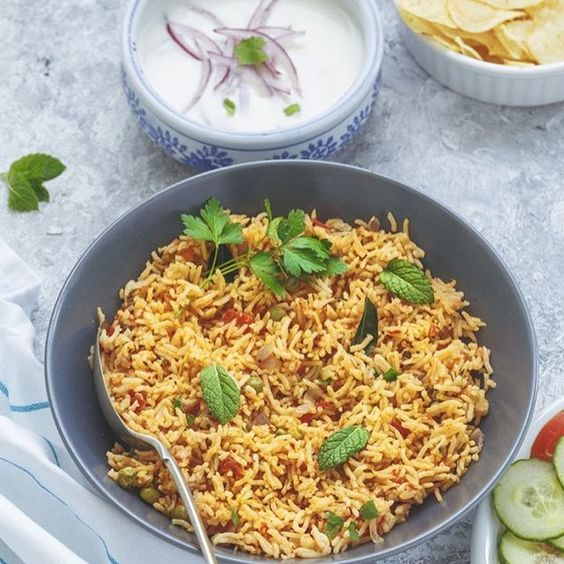 One pot TomAto Rice served with Raitha, potato chips and Salad. Now this is called comfort meal !! What is your version of comfort meal ?? Check out the recipe here - http://sandhyahariharan.co.uk/2016/06/24/tomato-rice/  #onepotmeal #meatlessMonday #vegan #comfortfood #tomato #rice #vegetarian #londonblogger #everydayindia #mumbai #food #cooking #indian #vegan #yumm #eeeats #instaphoto #food #foodblogger #styledfood #delicious #homemade