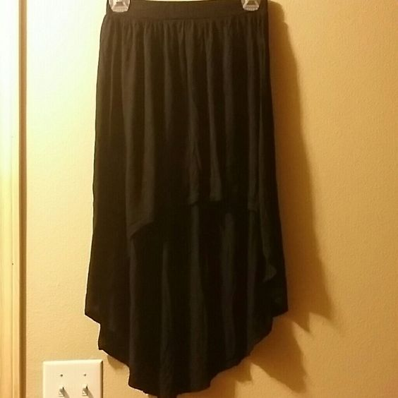 Black high- low skirt This all black skirts is very cute and has been very well-loved. There are no flaws with it it is in great condition it just doesn't fit me anymore it runs pretty small. There is no brand on it that I could find Skirts High Low