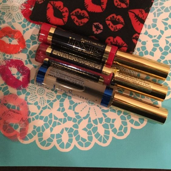 Bundle LipSense  blu-red and B. Ruby and gloss Long lasting lip color last 18 hours ,does not kiss off, rub off or smear off  and no feathering once it is applied SeneGence Makeup Lipstick