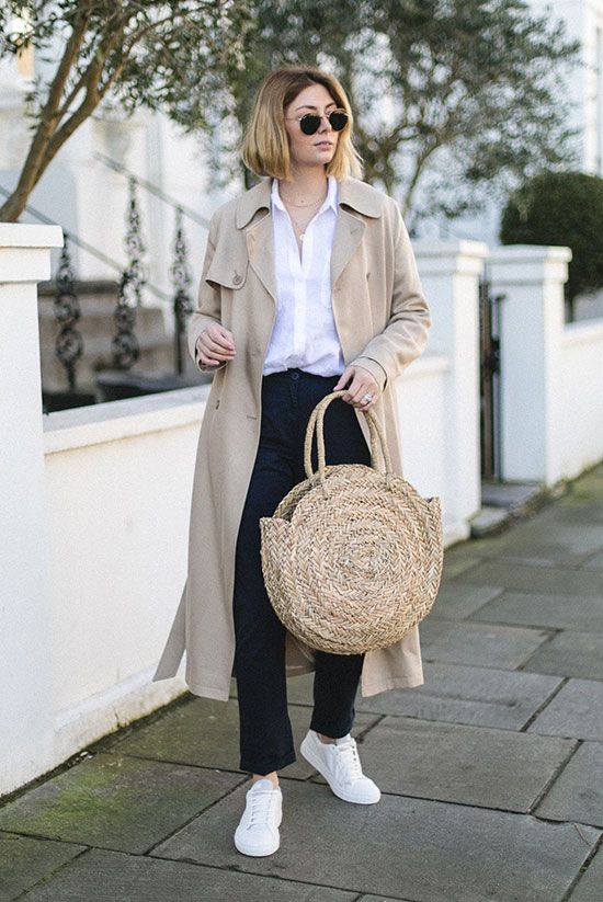 Oversized trench coat, white shirt, navy chinos, white sneakers, round aviator sunglasses, circle straw tote. #trenchcoat #ss18 #springstyle #streetstyle #stylish #fashion2018 #fashiontrends2018 #ootd #outfitideas #outfitinspiration #casualstyle #comfystyle #sneakers #whiteshirt #basics spring casual outfit, trench coat outfit