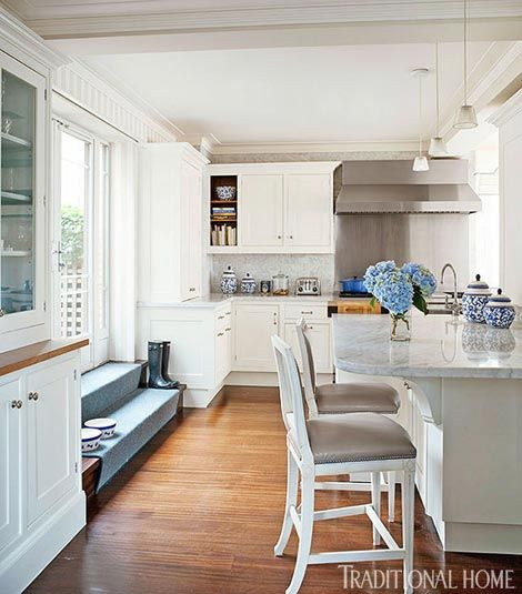 Steps Lead From The Open And Airy Kitchen To An Outdoor