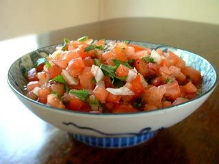 Mexican salsa recipe made with chopped fresh tomatoes, jalapeno and serano chili peppers, red onion, cilantro, and lime.  Also called Pico de Gallo or Salsa Fresca.