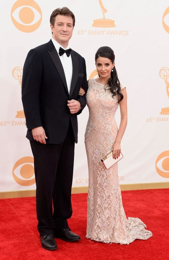Actor Nathan Fillion (L) and actress Mikaela Hoover... The dress looks flawless on her...