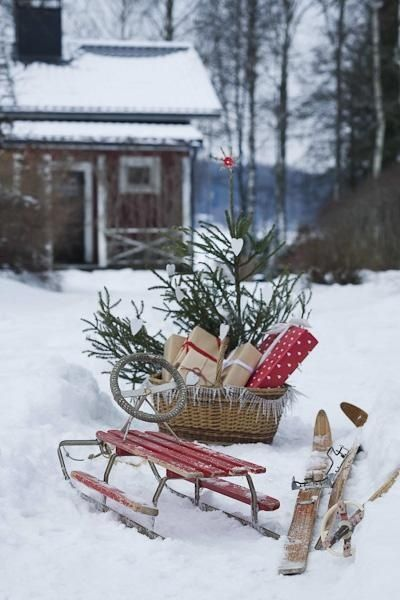 Charming Swedish Christmas Winterscape with vintage red sled and presents in a basket
