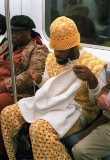 Crochet man knitting on the subway