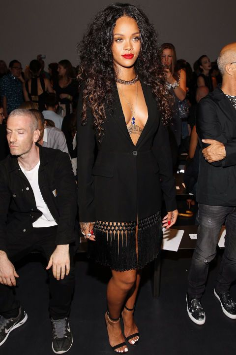 What: Altuzarra Where: Altuzarra Spring 2015 Show Why: Rihanna perfectly pairs a gold body chain with her low-cut fringe blazer.