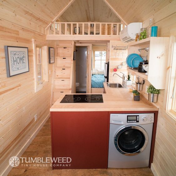 Tiny Home with staircase storage (no ladder, thankfully), washer/dryer combo, and bedroom on the first floor.: