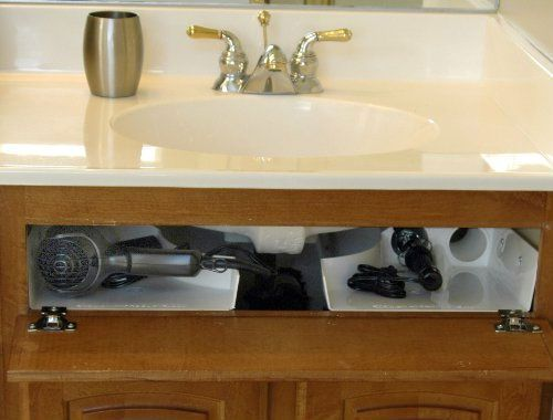 Curling iron and hair dryer stowaway ($39.95, Amazon.com), installed behind your bathroom cabinet's false front around the base of your sink basin.
