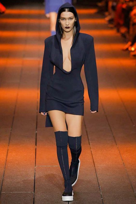 DKNY Spring 2017 Ready-to-Wear.. Bella Hadid opened the show in a plunging neckline hooded number.