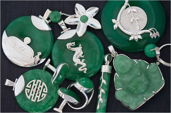 The sterling silver mounts of these Jade pendants highlight the beautiful deep colour of the natural stone