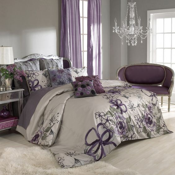 purple and grey bedroom - by keeping the walls a neutral grey you can add colour and pattern in the bed linen and accessory throw cushions.: