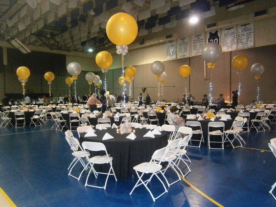 Gold and silver 3 foot balloons transform this gymnasium into a ballroom