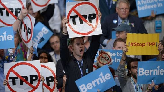 TPP: What is it and why does it matter? - BBC News   Delegates hold anti-TPP signs at the Democratic Party's convention in Philadelphia, Pennsylvania, 25 July 2016