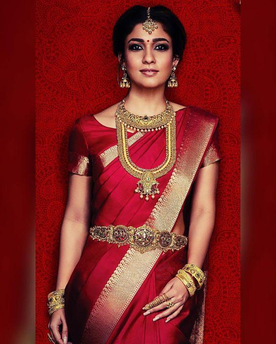 South Indian bride. Gold Indian bridal jewelry.Temple jewelry. Jhumkis. Red silk kanchipuram sari.braid with fresh jasmine flowers. Tamil bride. Telugu bride. Kannada bride. Hindu bride. Malayalee bride.Kerala bride.South Indian wedding. Nayanthara.