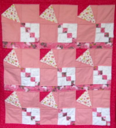 A handmade patchwork quilt will become a child's quilt to last a lifetime.