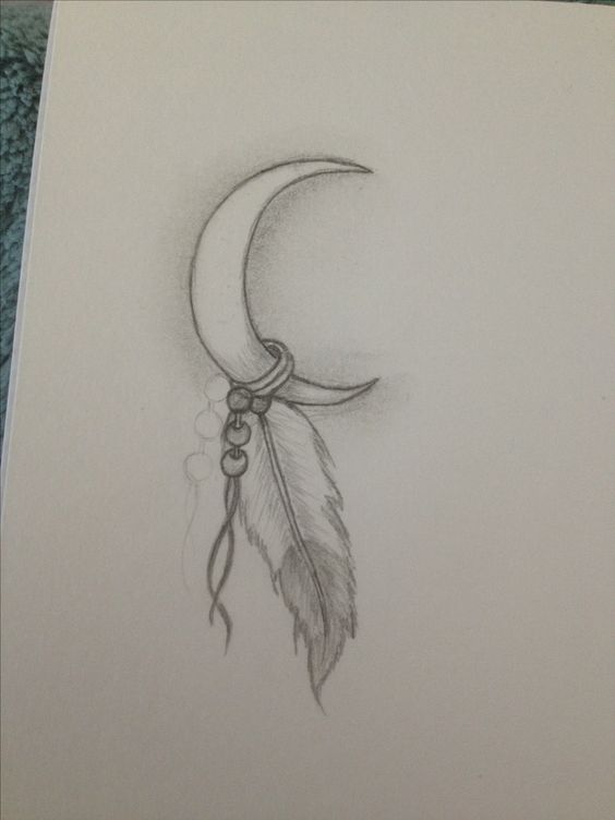 Drew my next tattoo its my Indian name. White moon feather... hmmm maybe I could find drawing to represent star blanket and swift wolf rather than just say their names... love it!
