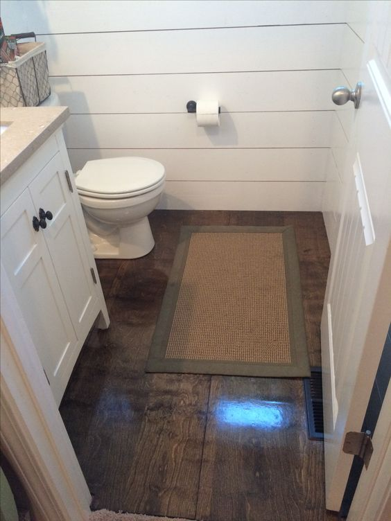 """Stain sande 3/4"""" plywood for an inexpensive faux hardwood floor!"""
