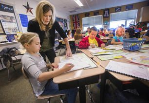 Foxboro Elementary School teacher Allison Riddle started her week like many others, working with students in her fifth-grade class