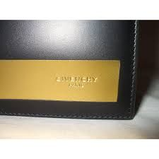 Image result for yellow  color givenchy wallet uk