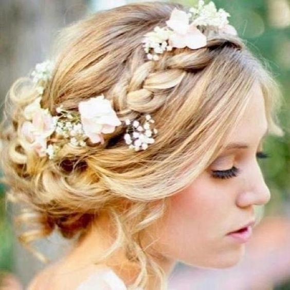 Beautiful updo; tossled curls twisted back into a messy loose bun, with a thick…