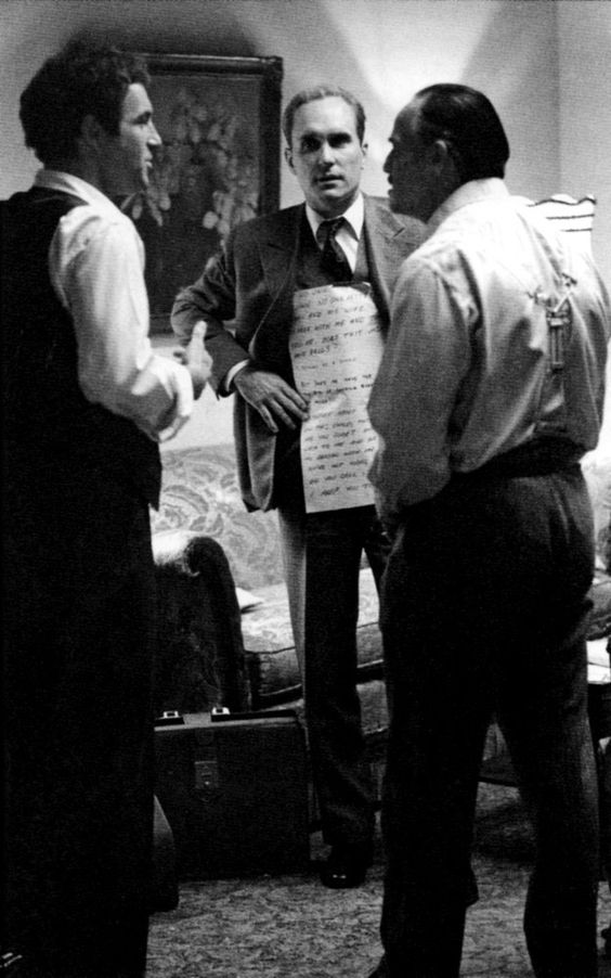 Tom Hagen (Robert Duvall) proving he was more than a consigliere for the Godfather (Marlon Brando) by providing him with the words to say.     Cue cards.