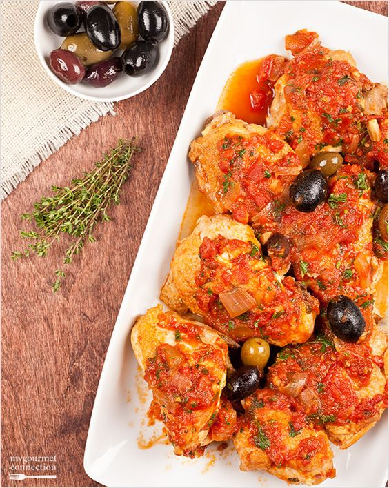 Chicken Cacciatore, or Hunter-Style Chicken is a simple, peasant-style combination of chicken flavored with onion and garlic and simmered in a light, white wine and tomato sauce.