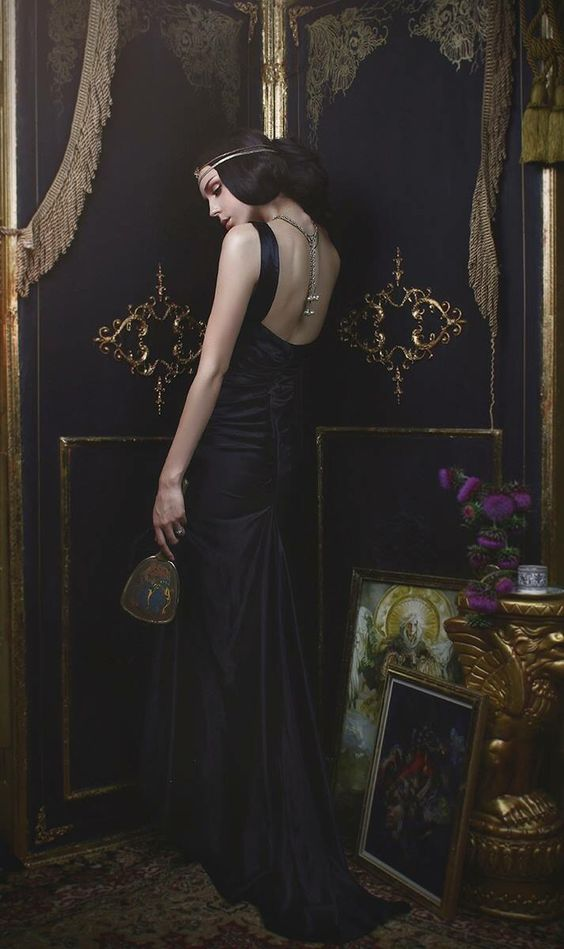 Back view of a woman  wearing a black gown