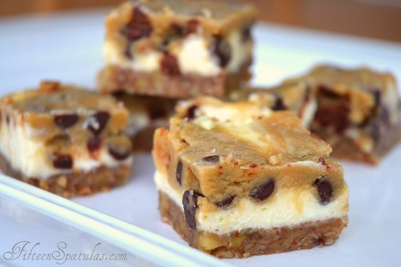 Cookie Dough Cheesecake Bars: A buttery pecan crust on the bottom, creamy cheesecake in the middle, and cookie dough on top!