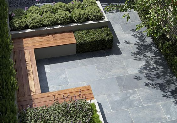 Built in seating, raised planters and slate tiles laid in stretcher bond pattern. Image © Steve Gorton
