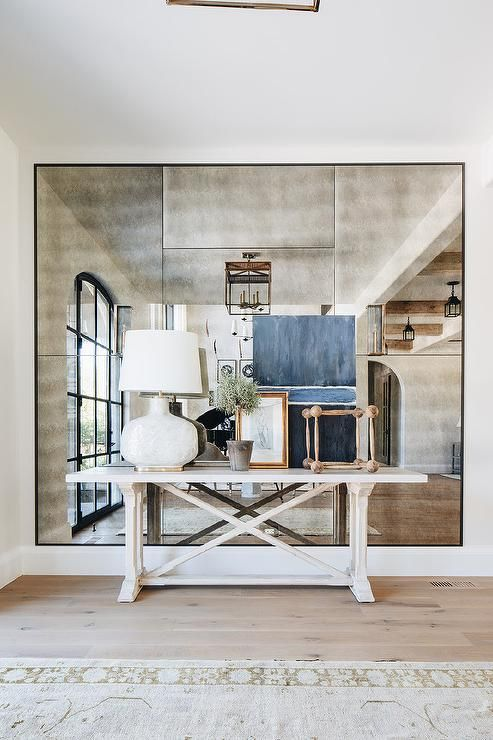 Smoke Mirror Wall Panels Are Fitted Behind A Whitewash French Console Table Lit By An Alabaster Lamp In 2020 Home Interior White Wainscoting