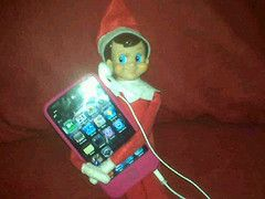 Elf on a Shelf jamming to music.
