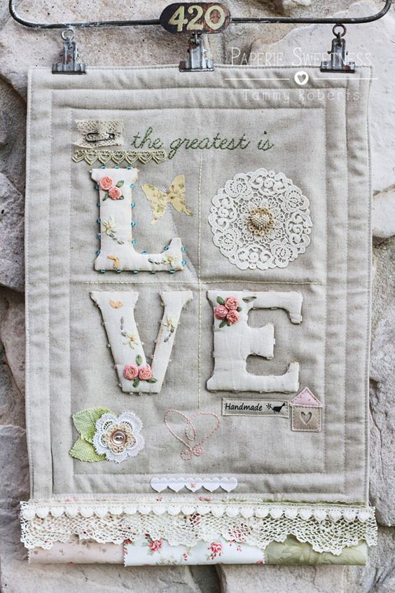"""Mini """"Love"""" quilted wall hanging using our #HeatnBond adhesives by Designer @Tammy Tarng Roberts!"""