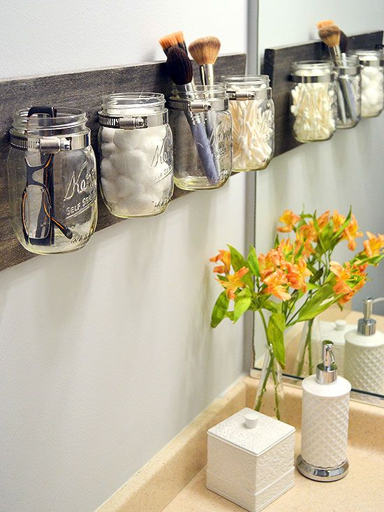 What if, between the soap dispenser and toothbrush holder, you just don't have any more counter space? Think upwards, and add a wall-mounted organization system. This wood and Mason jar rack holds cotton balls, cotton swabs, makeup brushes, spectacles, and more. Just think of the possibilities! Image: The DIY Playbook