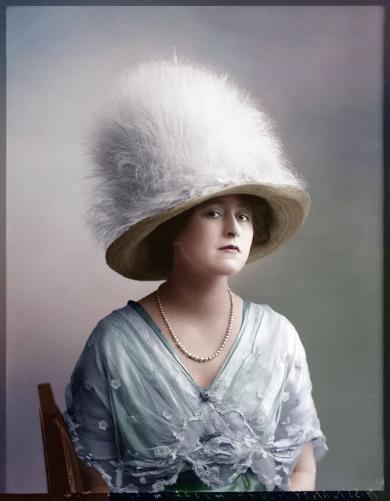 Nancy More, 1911, wow that is a big fluffy hat. and she has such a serious expression: