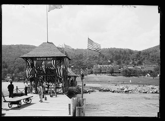 Pavilion with flags at Silver Bay wharf, Lake George, N.Y.