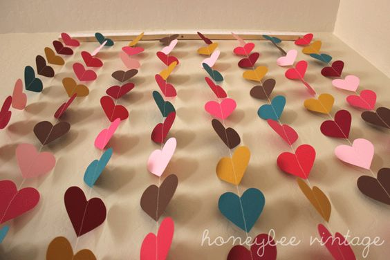 Honeybee Vintage: DIY: Paper Heart Wall Art, but I'd do a different design for the baby room.