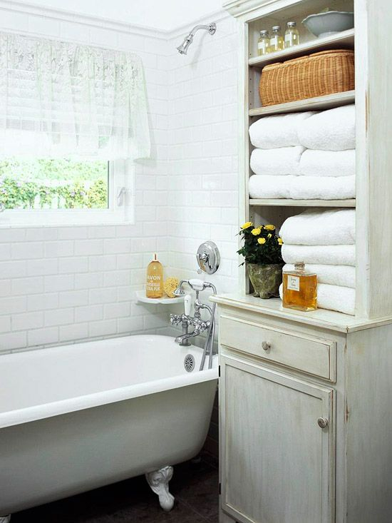 I like the effecient usage of the limited space in this bathroom. The hutch provide a convenient place to store towels, washrags, and toiletries so they are easy to reach from the tub. The window also offers an abundance of natural illumination to help shed some light on those personal grooming rituals we develop for ourselves.