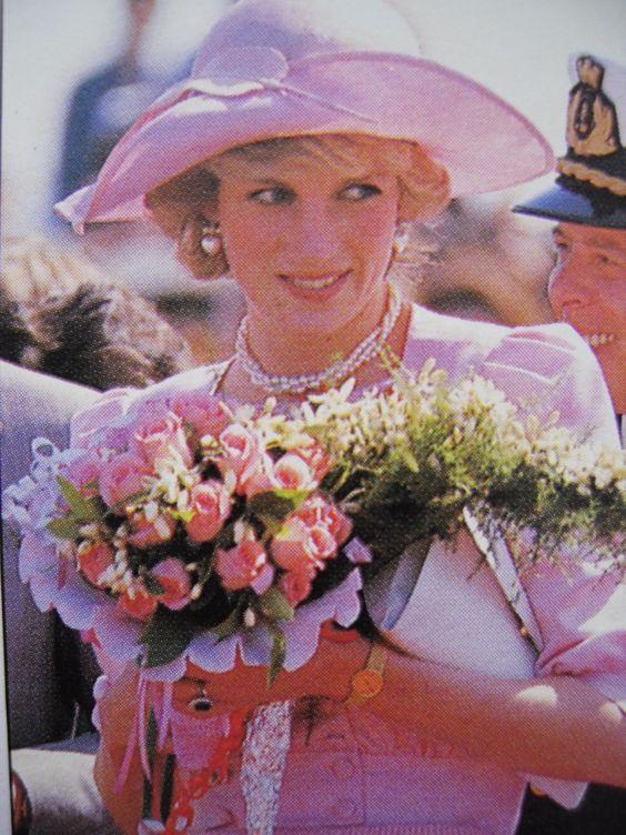 Diana in a pink ensemble by Catherine Walker. Hat by John Boyd.
