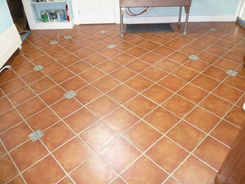 kitchen tile flooring tile floor installation by kerrie in a fall creek house under i dont like the color but i like the what seems random accent