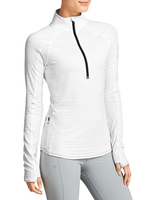 Running Wild Half Zip - Full wicking, breathable performance in a run top with Unstinkable technology, reflective tape and a back loop to hang your strobelight.