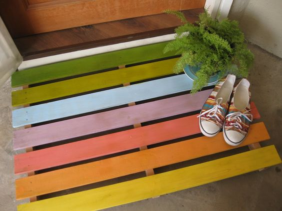 Welcome guests with this repurposed palette turned doormat.