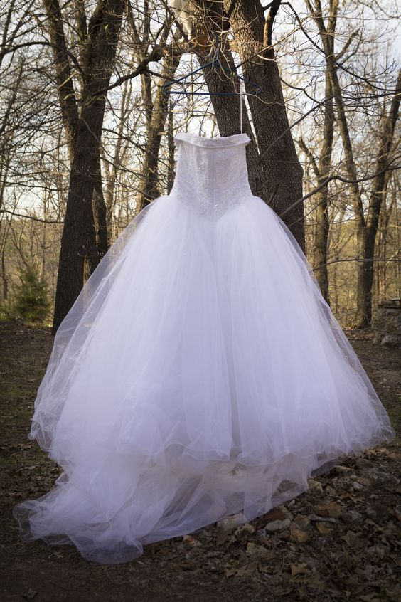 White Cinderella gown with beaded bodice. Layers upon layers of tulle! Size 10.
