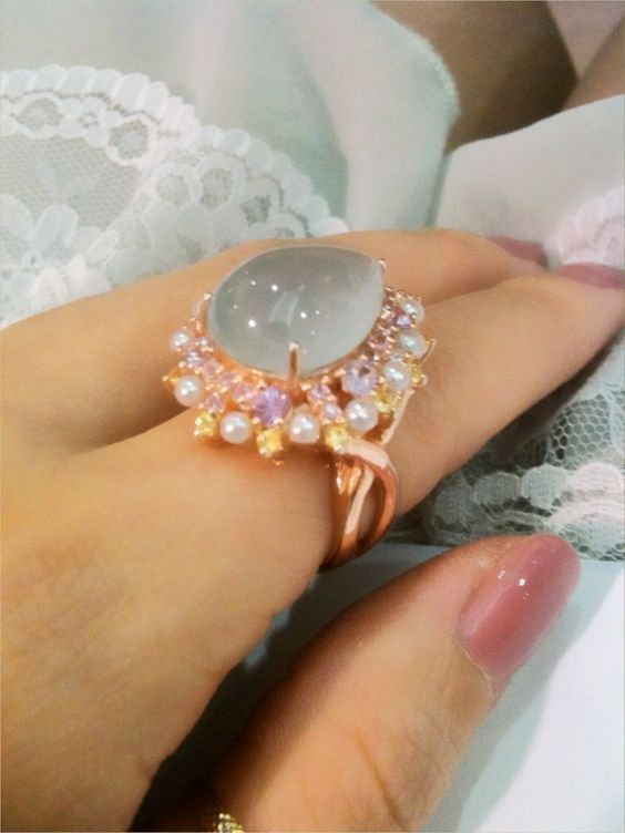 Cabochan aquamarine ring set with pastel yellow and pink sapphire along with tiny pearls. So unique!!