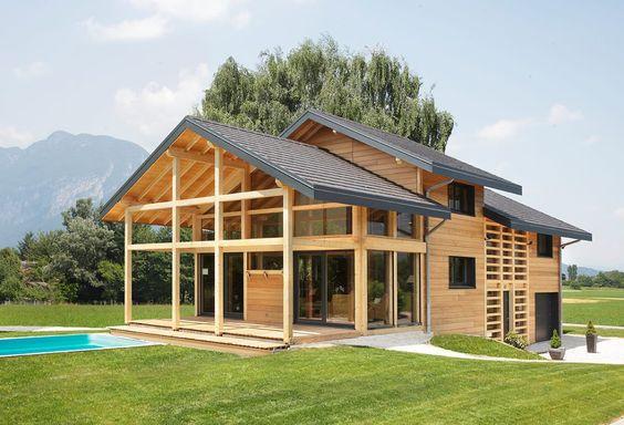 전문가들을 통해서 건축 아이디어 및 영감을 얻어보세요. Myotte-Duquet Habitat 의 Maison bois poteau-poutre | homify